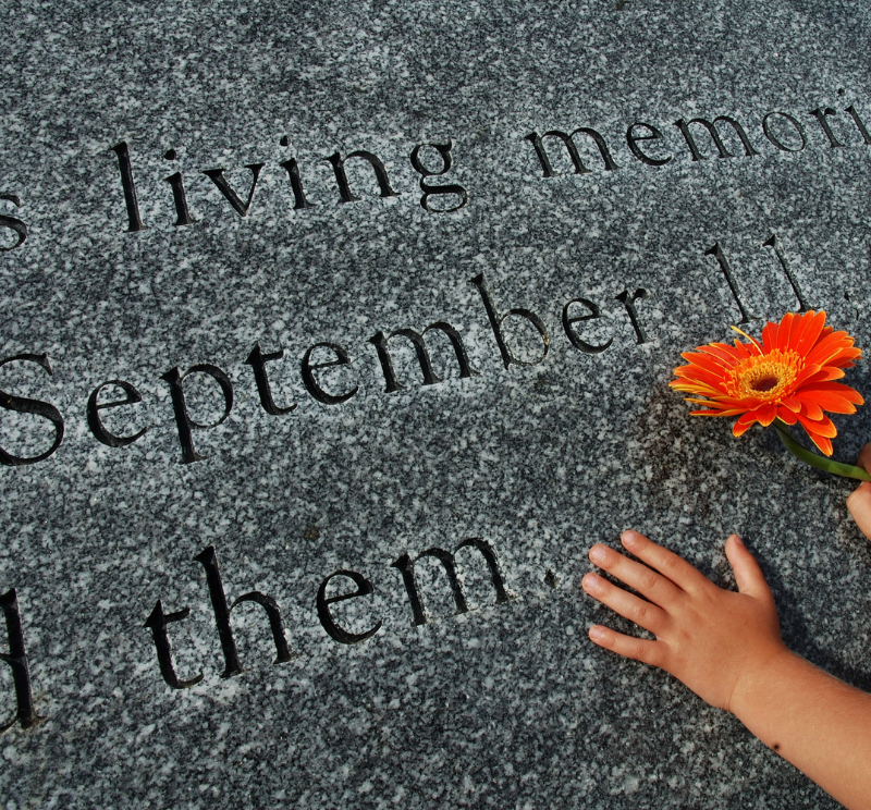 Hand and red flower on 911 Memorial