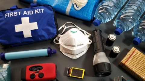 Emergency kit items such as first aid kit, water, flashlight and batteries