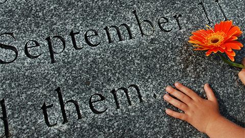 September 11 Memorial with hand holding flower